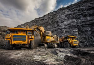 """Coal production at one of the open fields in the south of Siberia. Dumpers """"BelAZ"""". September 2015."""
